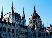 The Hungarian Parliament with the main dome. The Hungarian Parliament in Budapest with the main dome and smaller towers and many Gothic pointy windows stock image