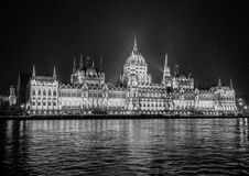Hungarian Parliament in Budapest at night. This picture was taken at night on board the pleasure boat. Black and white design Stock Images