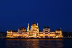 Hungarian Parliament Building 1. Hungarian Parliament along the Danube River in Budapest in the evening blue hours, illuminated by warm lighting Stock Image