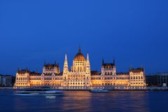 Hungarian Parliament Building 2. Hungarian Parliament Building along Danube River at night, with cruise ships in the foreground, Budapest Royalty Free Stock Photo