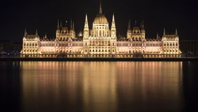 Hungarian Parliament Building in Budapest. At night. A long exposure taken from the other e of the Danube, with the lights reflected on the water Stock Photo