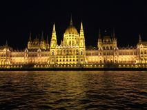 Hungarian Parliament Building front view. A front view of the Hungarian Parliament Building taken at night from a boat on the Danube Royalty Free Stock Image