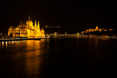 Hungarian Parliament Building located at the bank of the Dunabe river with famous Chain Bridge connecting Buda and Pest in Budapes Royalty Free Stock Images