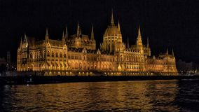 The Hungarian Parliament Building at night, from the Danube River royalty free stock photos