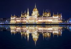 Hungarian Parliament Building at night with reflection in Danube river, Budapest, Hungary royalty free stock photography