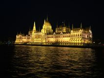 Hungarian Parliament Building at Night. The Hungarian Parliament Building taken at night from a boat on the Danube Stock Photos