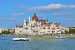Hungarian Parliament Building and two sightseeing ships, Budapest. Hungarian Parliament Building and two sightseeing ships on the Danube in Budapest, Hungary Royalty Free Stock Images