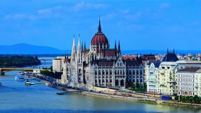 Hungarian parliament building view from other bank of river Danube with light clouds at sky, selective focus.  royalty free stock images