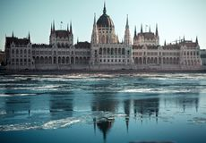Hungarian parliament building at winter. Budapest. River with ice royalty free stock photos