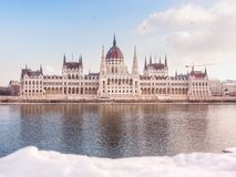 Hungarian parliament building at winter. Snow lies on the river bank, Budapest stock images