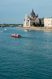 Hungarian Parliament and Danube. Hungarian Parliament in Budapest, with red boat on the Danube Stock Images