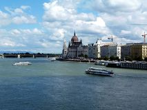 Hungarian Parliament and the Danube in panoramic landscape with white tour boats. The Hungarian Parliament in Neo Gothic style with the Danube in panoramic stock photography