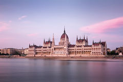 The Hungarian Parliament on the Danube riverbank at nightfall Royalty Free Stock Images