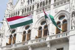 Hungarian Parliament hall. Hungarian flags outside the Hungarian Parliament, Budapest Stock Photography