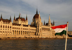 Budapest Parliament with hungarian flag. In front royalty free stock photo