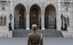 Hungarian Parliament - Main gate. BUDAPEST, HUNGARY, MARCH 24, 2017 - Hungarian soldier is guarding in front of the Parliament building Royalty Free Stock Image