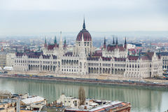 Hungarian parliament. The parliament neo-gothic building in rainy day with people and cars on street and Danube river in front Royalty Free Stock Photos