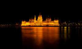 Hungarian parliament at night. Hungarian parliament reflection on danube at night Royalty Free Stock Image