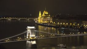 Hungarian Parliament and Szchenyi Chain Bridge over Danube river in Budapest. UHD 4K stock video footage