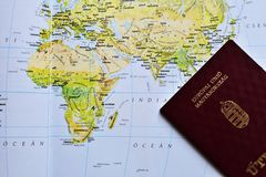 Hungarian passport on a map. Of Europe, Asia and Africa royalty free stock photography