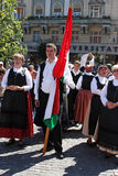 Hungarian people holding a flag Royalty Free Stock Photography