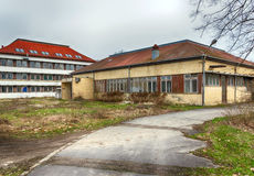 Hungarian rural decay - abandoned and ruined  buildings by the sidewalk.  Royalty Free Stock Photo