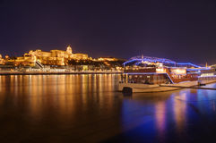 Hungary, Budapest, Castle Buda - night picture. Beautiful lights and reflections in Danube river. Restaurant and night club on the ship is in front of the Royalty Free Stock Photography
