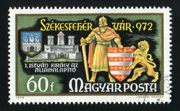 HUNGARY - CIRCA 1972: A post stamp printed in Hungary, shows King Stephen and shield, circa 1972 royalty free stock photography