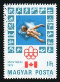 HUNGARY - CIRCA 1976: A postage stamp printed by Hungary, shows Montreal Olympic Emblem, circa 1976 Stock Photography