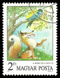 Fox and the Crow, Aesop`s Fables. Hungary - circa 1987: Stamp printed by Hungary, Color edition on topic of Fairy Tales, shows The Fox and the Crow, Aesop`s royalty free stock images