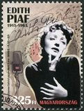 HUNGARY - 2015: shows Edith Piaf 1915-1963, singer. HUNGARY - CIRCA 2015: A stamp printed in Hungary shows Edith Piaf 1915-1963, singer, circa 2015 royalty free stock photos