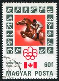 Equestrian. HUNGARY - CIRCA 1976: stamp printed by Hungary, shows Montreal Olympic Emblem, Canadian Flag, Equestrian, circa 1976 Royalty Free Stock Photography