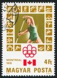 Javelin. HUNGARY - CIRCA 1976: stamp printed by Hungary, shows Montreal Olympic Emblem, Canadian Flag, Javelin, circa 1976 Royalty Free Stock Image