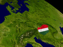 Hungary with flag on Earth Stock Photo