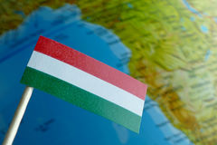 Hungary flag with a globe map as a background Stock Photo