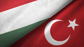 Hungary and Turkey two flags textile cloth, fabric texture vector illustration