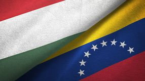 Hungary and Venezuela two flags textile cloth, fabric texture vector illustration
