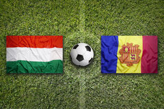 Hungary vs. Andorra flags on soccer field Stock Photo