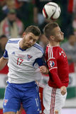 Hungary vs. Faroe Islands UEFA Euro 2016 qualifier football matc. BUDAPEST, HUNGARY - OCTOBER 8, 2015: Air battle between Hungarian Adam Bodi (r) and Faroese Stock Photo
