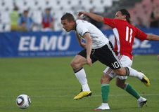 Hungary vs Germany friendly football game. BUDAPEST - MAY 29: Hungary vs Germany friendly football game. Duel of Podolski (GER, 10) and Huszti (HUN, 11) on May Stock Photo
