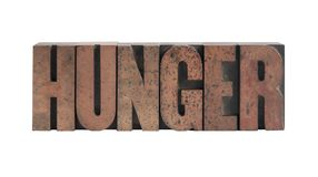 Hunger. The word 'hunger' in old, ink-stained wood type Stock Photography