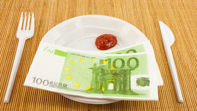 The hunger for money, 100 euros napkins, ketchup, plastic fork and knife Stock Photos