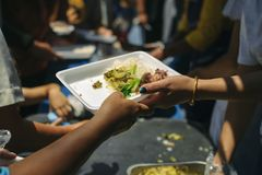 Hunger problems of the poor have been donated food to reduce hunger : the concept of food shortage in the world : Donate Food with. Love and Hope to the Poor stock photography