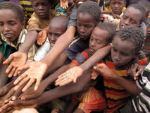 Hunger Refugee Camp. DADAAB, SOMALIA-AUGUST 15: Children stretch out their hands at the Dadaab refugee camp where thousands of Somalian wait for help because of