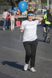Hunger Run (Rome) - WFP - Girl with event bandana & balloon Stock Images