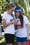 Hunger Run (Rome) - WFP - Two girls with mobile phone. The HUNGER RUN – a 10k competitive race and a 5k fun run/walk - 19 October 2014 – meeting at 8:30 a.m Stock Photo