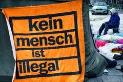 Hunger strike of refugees. MUNICH, GERMANY - NOVEMBER 24 - Refugees on hunger strike at the sendlingertor on November 24, 2014 in Munich Royalty Free Stock Photography