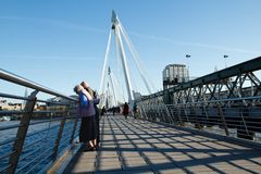 Hungerford Bridge. LONDON - NOVEMBER 14: Elderly pair on Hungerford Bridge on November 14, 2012 in London. This footbridge was designed by Lifschutz Davidson Stock Photos