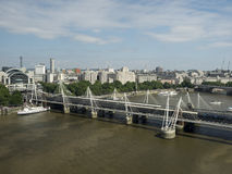 Hungerford Bridge and Golden Jubilee Bridges, London. The Hungerford Bridge crosses the River Thames in London, and lies between Waterloo Bridge and Westminster Stock Images