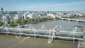 Hungerford Bridge and Golden Jubilee Bridges at London, United Kingdom. Hungerford Bridge and Golden Jubilee Bridges at London. A view from the above Stock Photo
